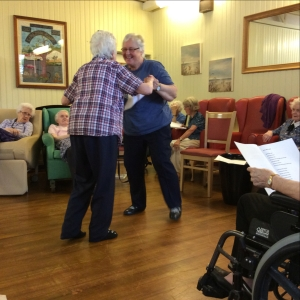 "Mary and Janette dancing to ""White Cliffs of Dover""."